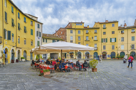 LUCCA, ITALY, JANUARY - 2018 - Winter season shot at famous piazza anfiteatro at historic center of Lucca city, Italy