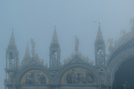 VENICE, ITALY, JANUARY - 2018 - Winter foggy scene detail view of san marcos cathedral at piazza san marcos in venice city, Italy Editorial