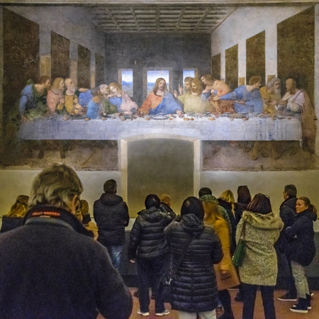 MILAN, ITALY, JANUARY - 2018 - People watching Leonardo da Vinci most famous last dinner painting located at santa maria delle grazie church in milan city.