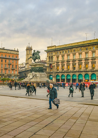 MILAN, ITALY, JANUARY - 2018 - Urban scene at famous duomo piazza at historic center of milan city, Italy