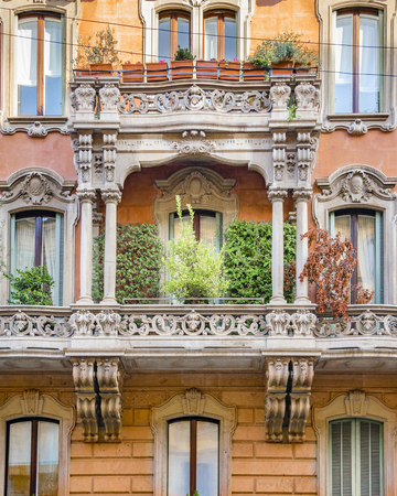 Exterior facade elegant old style apartment buildings at milan city