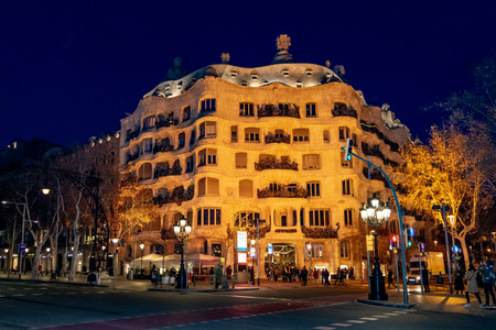 BARCELONA, SPAIN, JANUARY - 2018 - Exterior night view of la pedrera building, a famous gaudi masterpiece atchitecture located in barcelona city, spain