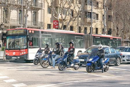 BARCELONA, SPAIN, JANUARY - 2018 - Urban day traffic scene at avenue in barcelona city.