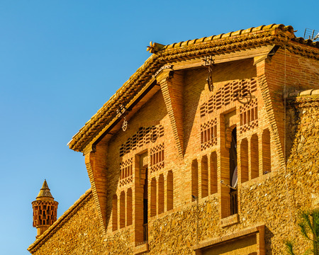 Exterior view of colonia guell building located at Santo Coloma de Cervello town, Catalunya, Spain Editorial