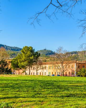 Rural landscaspe scene with buildings at background at Santa Coloma de Cervello Town,  Catalonia, Spain 報道画像