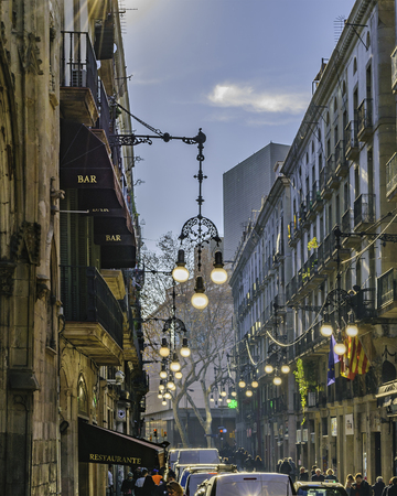 BARCELONA, SPAIN, JANUARY - 2018 - Perspective view at traditional street at gothic district in barcelona city, spain