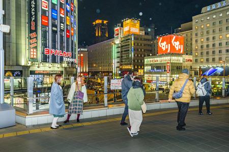 OSAKA, JAPAN, JANUARY - 2019 - People walking urban night scene at osaka city, japan