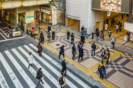 OSAKA, JAPAN, JANUARY - 2019 - Urban winter day scene people crossing street at osaka downtown, japan