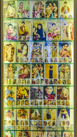 SHANGHAI, CHINA, DECEMBER - 2018 - Colored portrait illustration posters of chinese people lifestyle at store in shanghai city, china Imagens - 124999243