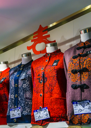 SHANGHAI, CHINA, DECEMBER - 2018 - Traditional asian clothing store at yuyuan garden commercial mall in shanghai city, china
