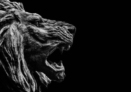 Scray background style with angry expression lion head sculpture over black background