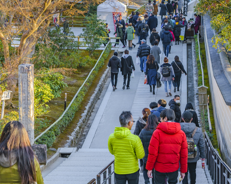 KYOTO, JAPAN, JANUARY - 2019 - Tourists at entrance of famous kinkakuji zen temple at Kyoto city, japan Editorial