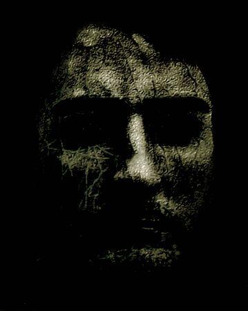 Creepy digital manipulation technique photography of man head against dark background Stock Photo