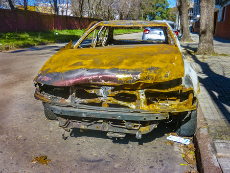 MONTEVIDEO, URUGUAY, AUGUST - 2019 - Burnt car parked at street in montevideo city, uruguay