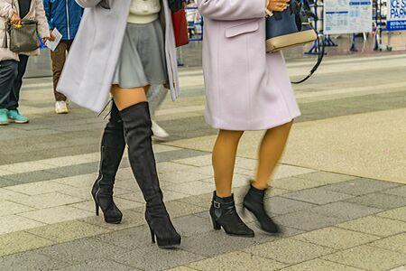TOKYO, JAPAN, JANUARY - 2019 - Two elegant women walking at street, tokyo, japan