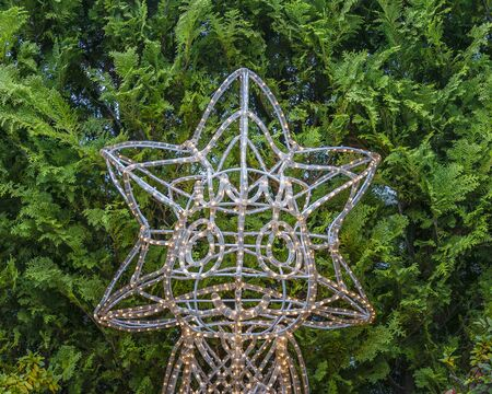 Japanese character christmas sculpture surrounded by plants, toyko, japan Banco de Imagens