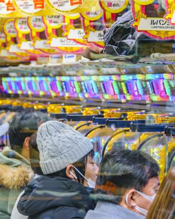 TOKYO, JAPAN, JANUARY- 2019 - People playing pachinko machines at tokyo city, japan Publikacyjne