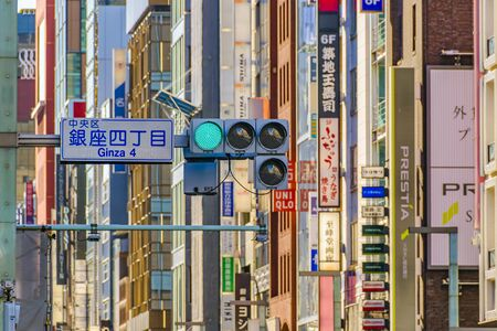 TOKYO, JAPAN, JANUARY - 2019 - Traffic light and buildings at background at ginza district, tokyo, japan