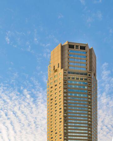 TOKYO, JAPAN, JANUARY - 2019 - Low angle shot modern tall buildings at famous shibuya neighborhood in tokyo city, japan