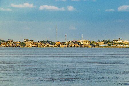 Landscape scene of riverfront daule city and babahoyo river at guayas district, ecuador