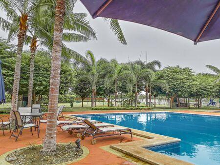 Residential outdoor swimming pool at high class samborondon district, guayas, ecuador