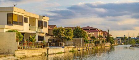 Waterfront houses at high class neighborhood houses at samborondon district, Ecuador Stock Photo
