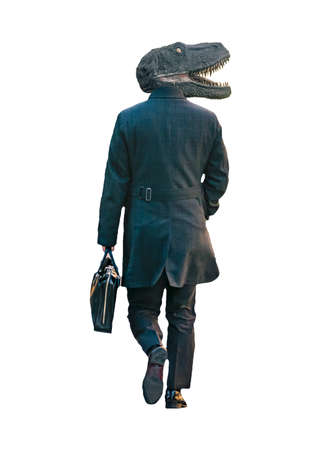 Back view shot executive man with dinosaur head carrying briefcase walking isolated photo