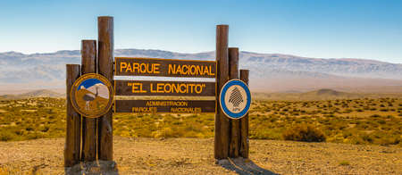 "Wooden cartel with spanish text ""el leoncito national park administration"" at el leoncito national park, calingasta district, san juan province, argentina"