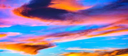 Panoramic colorful sunset cloudscape scene photo