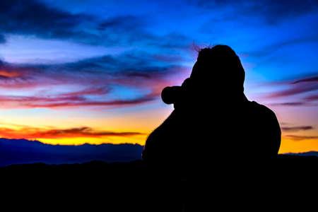SAN JUAN, ARGENTINA, APRIL - 2019 - Man taking photos of sunset landscape at el leoncito national park, calingasta district, san juan province, argentina