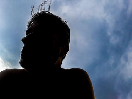 Man portrait silhouette over blue sky background