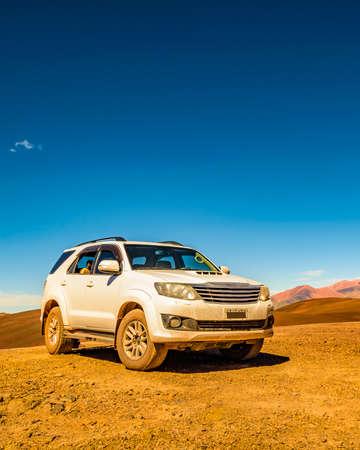 Van parked at andean landscape at brava lagoon, la rioja province, argentina
