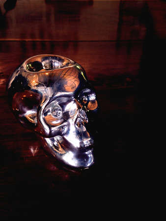 silver: Silver skull on wood background