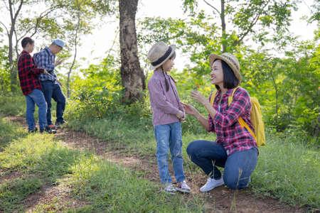 Asian family trekking together on vacation Standard-Bild