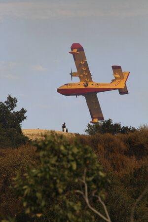 bombardier: Super Scooper Flys by People on Hill