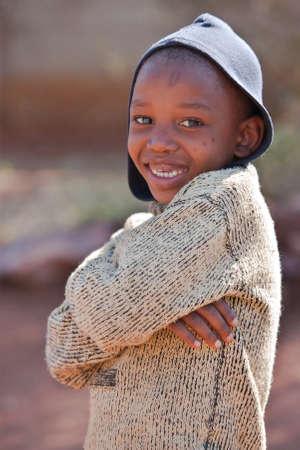 Poor African child from Mochudi village, Botswana photo