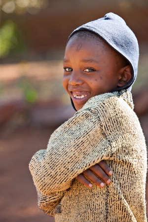 Poor African kid from Mochudi village, Botswana photo
