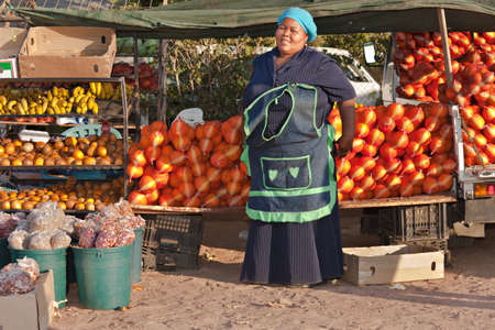 poor african: Mid age African sales woman from Mochudi village, Botswana