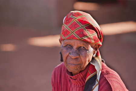 shortage: Poor and old African woman