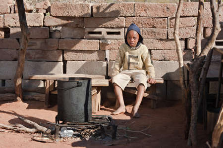 Poor African child from Mochudi village, Botswana photo