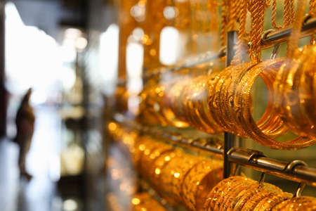 gold souk: Gold bangles in a Dubai gold souk  United Arab Emirates Stock Photo