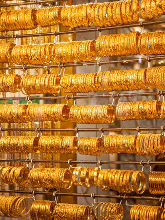 Gold bangles in a Dubai gold souk  United Arab Emirates photo