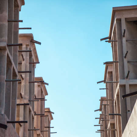 past civilization: Arabian Wind Towers on the top of a house in Dubai, United Arab Emirates  Wind Towers were used in the arab architecture to cool the buildings   Stock Photo