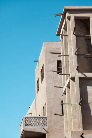 bur dubai: Arabian Wind Towers on the top of a house in Dubai, United Arab Emirates  Wind Towers were used in the arab architecture to cool the buildings   Stock Photo