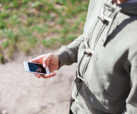 Close up of a young man using smartphone photo
