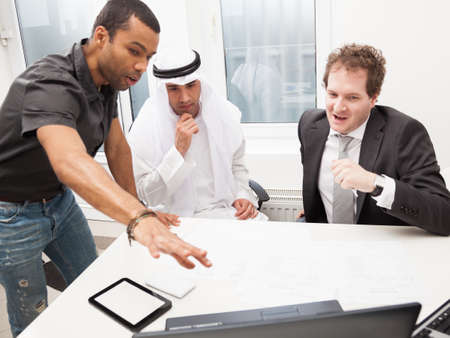 Young architect showing his project to business partners photo