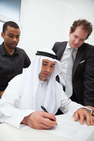 arab people: Business partners working in the office. Signing the contract