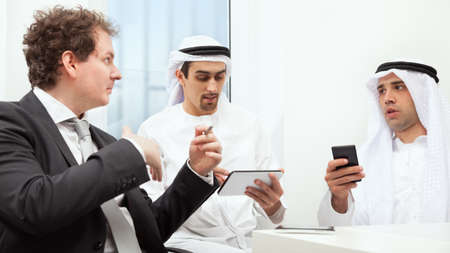 Group of business people working and discussing photo