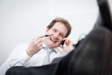 Portrait of smiling businessman on the phone photo