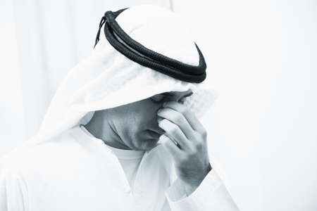 arab people: Portrait of stressed Middle Eastern businessman with headache